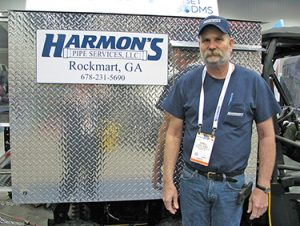 Owner Terrell Harmon stands in front of the rugged diamond plate housing of his Cobra Technologies UTV-mounted CCTV pipeline inspection system