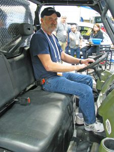 Terrell Harmon driving his UTV-mounted CCTV inspection system